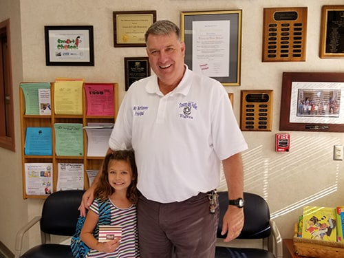 Principal Paul Martinsen and Molly Stimac